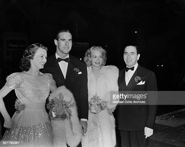 Actresses Janet Gaynor and Jane Wyman arrive at an event in Los Angeles California
