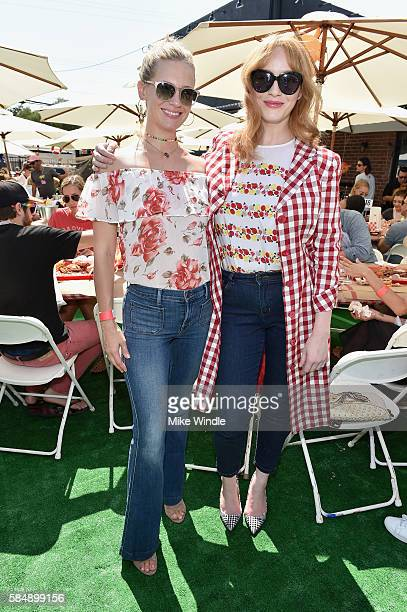 Actresses January Jones and Christina Hendricks attend the 4th Annual Crab Cake LA fundraiser event presented by Cadillac and Agavero to benefit...