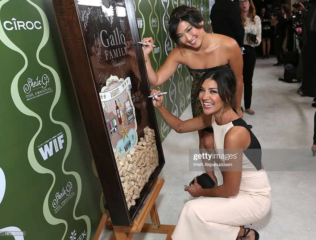 Actresses Jenna Ushkowitz and Jessica Szohr attend Variety & Women In Film Pre-Emmy Event presented by Yoplait Greek at Scarpetta on September 20, 2013 in Beverly Hills, California.