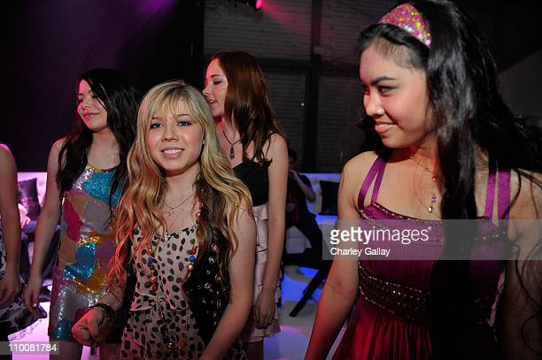 Actresses Jennette McCurdy and Ashley Argota dance at Miranda Cosgrove's Sweet 16 Party at Siren on May 16, 2009 in Los Angeles, California.