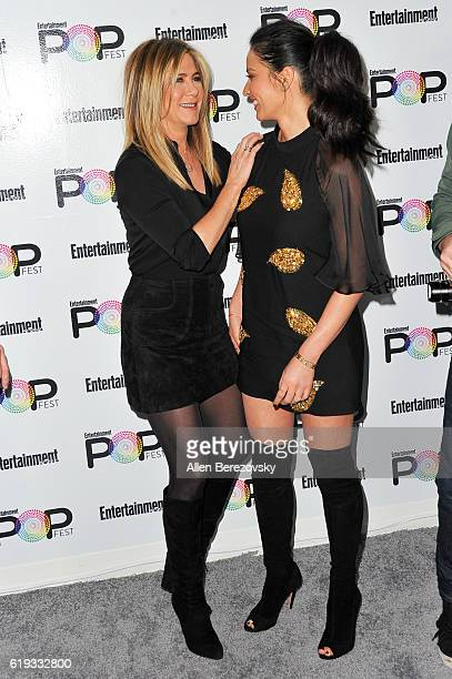 Actresses Jennifer Aniston and Olivia Munn attend Entertainment Weekly's Popfest at The Reef on October 30 2016 in Los Angeles California