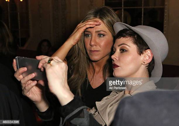 Actresses Jennifer Aniston and Rose McGowan pose for a selfie during the CAKE party for Jennifer Aniston hosted by Perrier-Jouet And Cinelou Films at...
