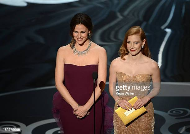 Actresses Jennifer Garner and Jessica Chastain present onstage during the Oscars held at the Dolby Theatre on February 24 2013 in Hollywood California