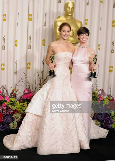 Actresses Jennifer Lawrence and Anne Hathaway pose in the press room during the Oscars at the Loews Hollywood Hotel on February 24, 2013 in...