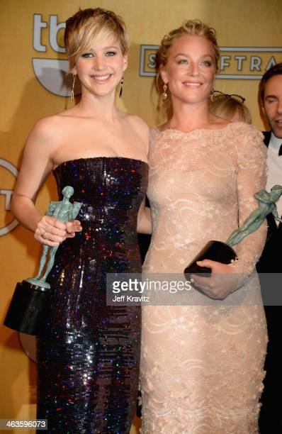 Actresses Jennifer Lawrence and Elisabeth Röhm pose in the press room during the 20th Annual Screen Actors Guild Awards at The Shrine Auditorium on...