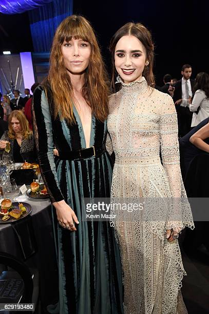 Actresses Jessica Biel and Lily Collins attend The 22nd Annual Critics' Choice Awards at Barker Hangar on December 11, 2016 in Santa Monica,...