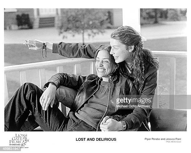 Actresses Jessica Pare Piper Perabo on set of the movie Lost and Delirious circa 2001