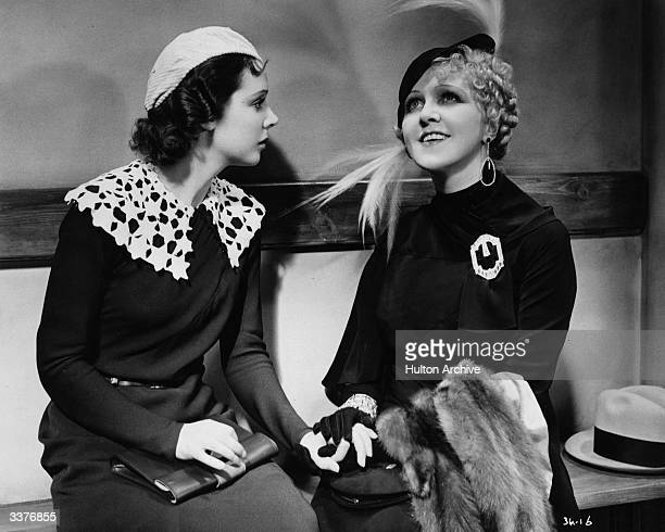 Actresses Jessie Matthews and Betty Balfour play two stylish young women in a scene from the film 'Evergreen' directed by Victor Saville for Gaumont