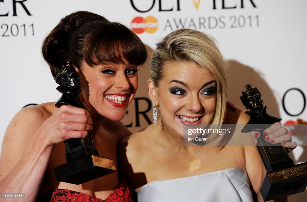 Actresses Jill Halfpenny (L), winner of Best Performance in a Supporting Role in a Musical and Sheridan Smith, winner of Best Actress in a Musical for 'Legally Blonde' pose in the press room during The Olivier Awards 2011 at Theatre Royal on March 13, 2011 in London, England.