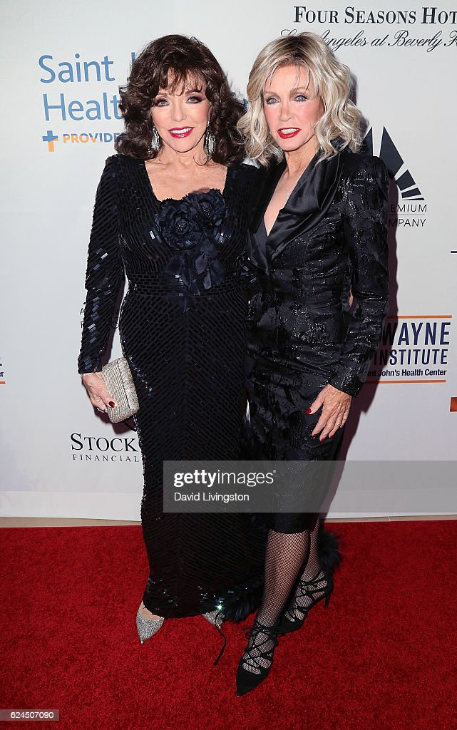 Actresses Joan Collins (L) and Donna Mills attend the Talk of the Town Gala 2016 at The Beverly Hilton Hotel on November 19, 2016 in Beverly Hills, California.