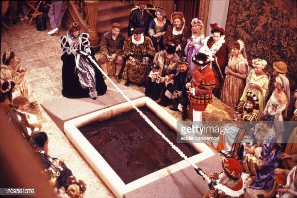 Actresses Joan Collins and Linda Evans in a tug-of-war over a mud pit during filming of a medieval scene for the TV series Dynasty in September 1987....
