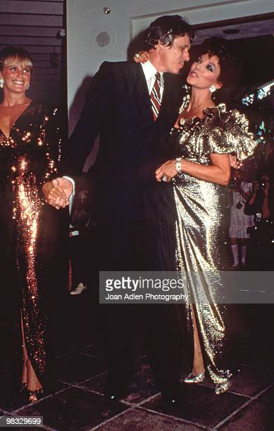 Actresses Joan Collins and Linda Evans with designer Nolan Miller attend a private showing of 'The Dynasty Collection' on Sept 19 1987 in Los Angeles...