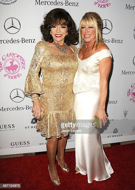 Actresses Joan Collins and Suzanne Somers attend the 2014 Carousel of Hope Ball at The Beverly Hilton Hotel on October 11 2014 in Beverly Hills...