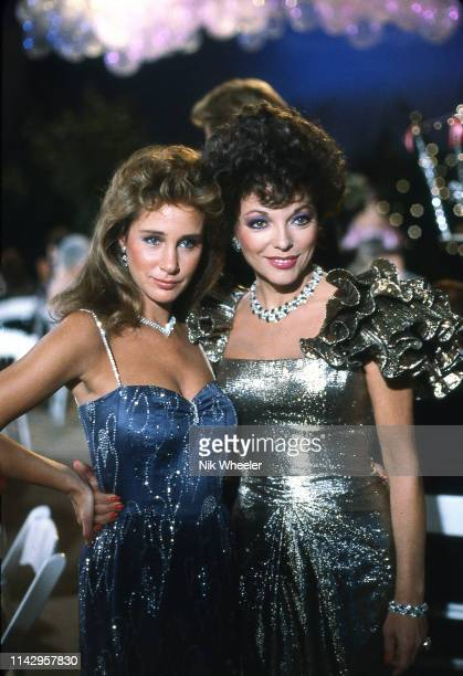 Actresses Joan Collins who plays Alexis and Pamela Bellwood who plays Cludia on the set of the 1980s television hit show soap opera Dynasty circa 1984