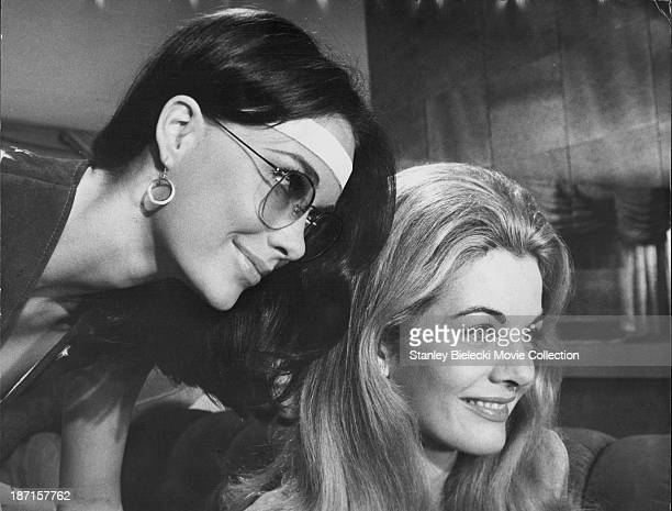Actresses JoAnna Cameron and Joanna Barnes in a scene from the movie 'B S I Love You' 1971
