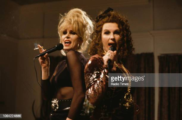 Actresses Joanna Lumley and Jennifer Saunders singing in a scene from episode 'Fashion' of the television sitcom 'Absolutely Fabulous', June 28th...
