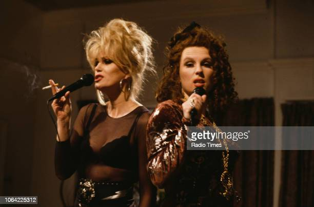 Actresses Joanna Lumley and Jennifer Saunders singing karaoke in a scene from episode 'Birthday' of the television sitcom 'Absolutely Fabulous',...