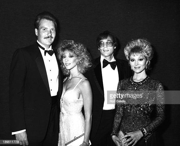 Actresses Judy Landers and Audrey Landers actor Ed Bessell and guest attend 14th Annual American Music Awards on January 26 1987 at the Shine...