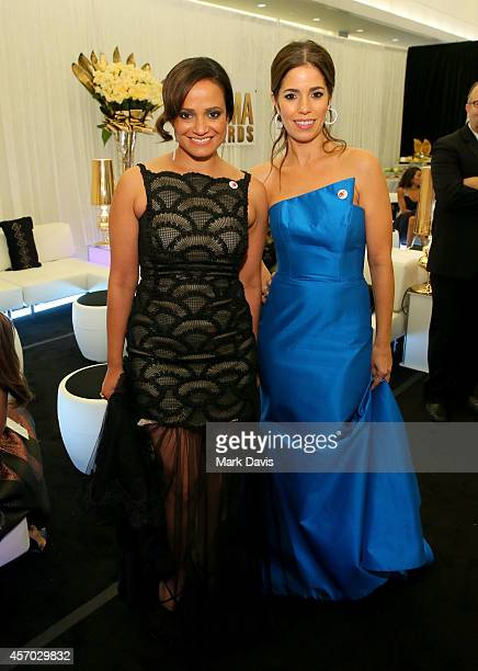 Actresses Judy Reyes and Ana Ortiz backstage at the 2014 NCLR ALMA Awards at the Pasadena Civic Auditorium on October 10 2014 in Pasadena California