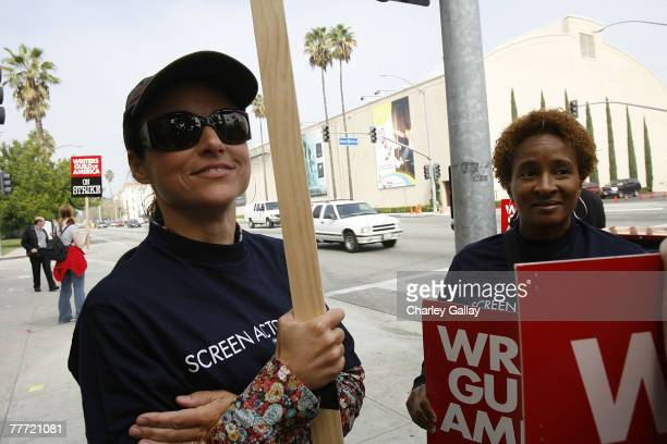 Actresses Julia LouisDreyfus and Wanda Sykes protest in support of striking Hollywood writers outside of the Warner Brothers studio in Burbank...