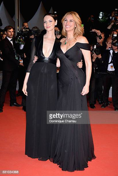 Actresses Julia Roberts and Caitriona Balfe attend the Money Monster premiere during the 69th annual Cannes Film Festival at the Palais des Festivals...