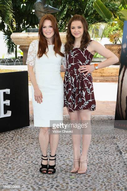"""Actresses Julianne Moore and Chloe Grace Moretz attend a photocall to promote the film """"Carrie"""" during the Summer Of Sony 2013 event on April 18,..."""