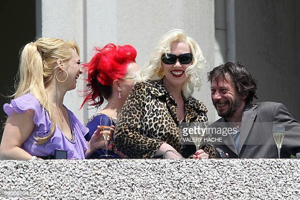 Actresses Julie Atlas Muz Dirty Martini and Mimi Le Meaux playing in the film of French director and actor Mathieu Amalric On Tour drink champagne on...