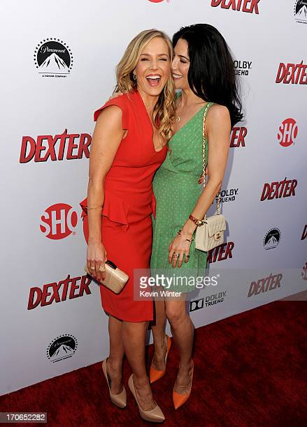 Actresses Julie Benz and Jaime Murray arrive at the premiere screening of Showtime's Dexter Season 8 at Milk Studios on June 15 2013 in Los Angeles...