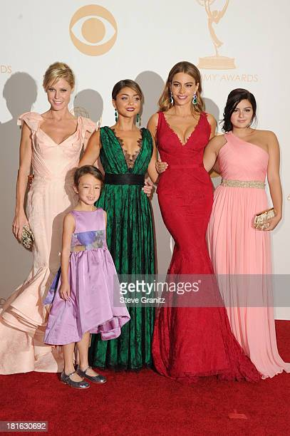 Actresses Julie Bowen Aubrey AndersonEmmons Sarah Hyland Sofia Vergara and Ariel Winter pose in the press room during the 65th Annual Primetime Emmy...