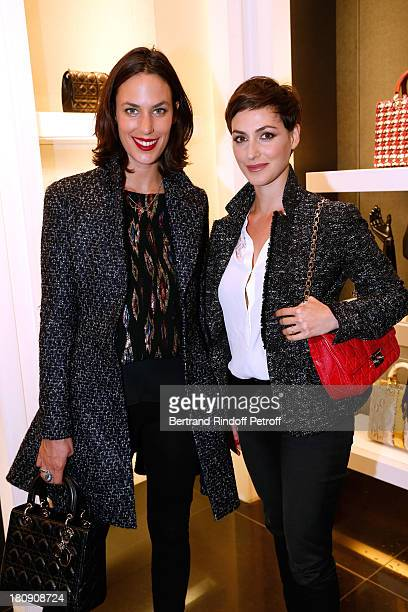 Actresses Julie Fournier and Clemence Thioly attend 'Vogue Fashion Night Out 2013' at Dior Rue Royale in Paris on September 17 2013 in Paris France