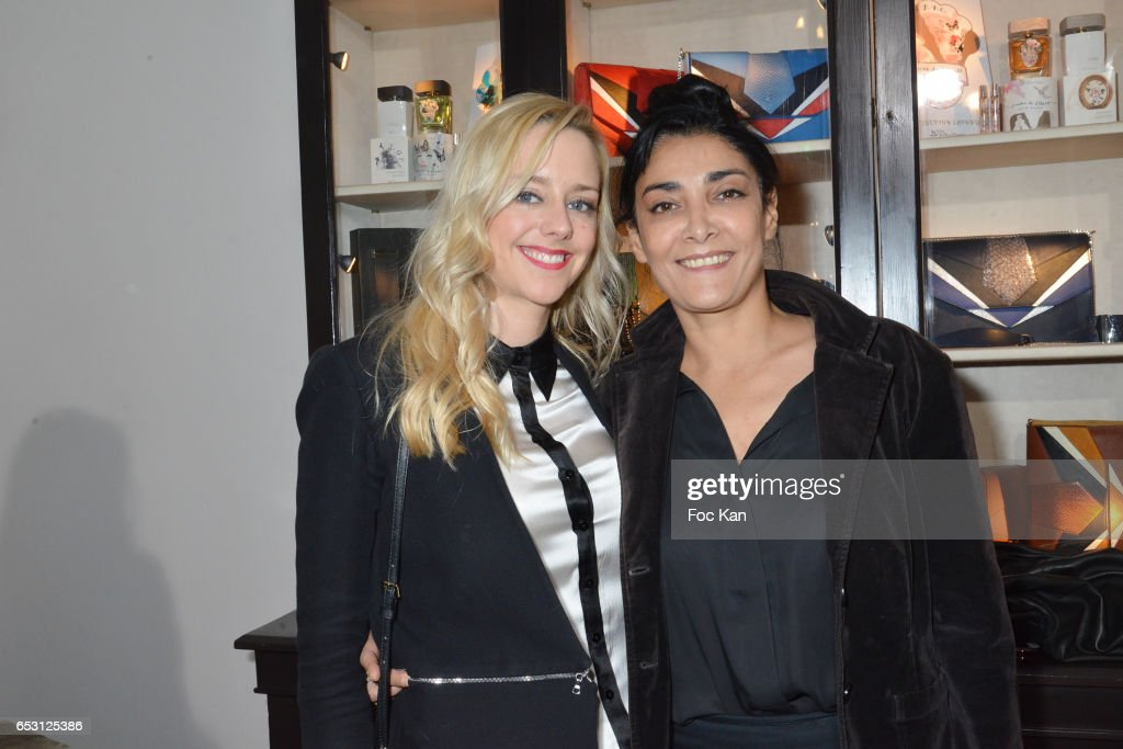 Actresses Julie Nicolet and Fatima Adoum attend William Arlotti Show at Hotel Lancaster Hosted by Domaine de La Croix wines on March 13, 2017 in Paris, France.