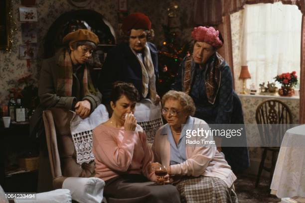 Actresses Juliette Kaplan Jane Freeman and Kathy Staff with Sarah Thomas and Thora Hird in a scene from the Christmas special episode 'Barry's...