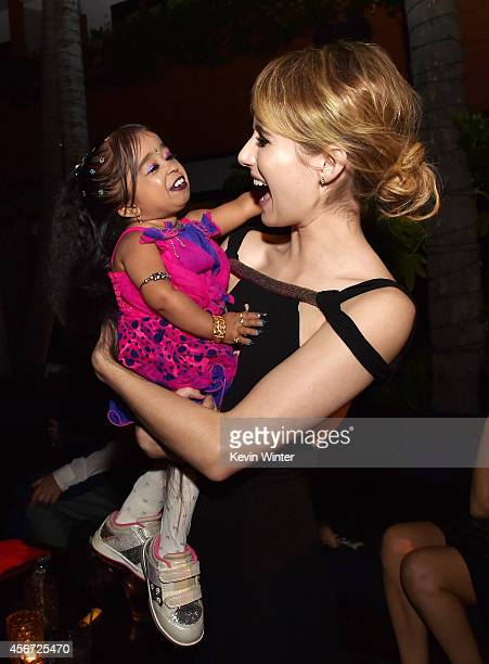 Actresses Jyoti Amge and Emma Roberts pose at the after party for the premiere screening of FX's American Horror Story Freak Show at the Roosevelt...