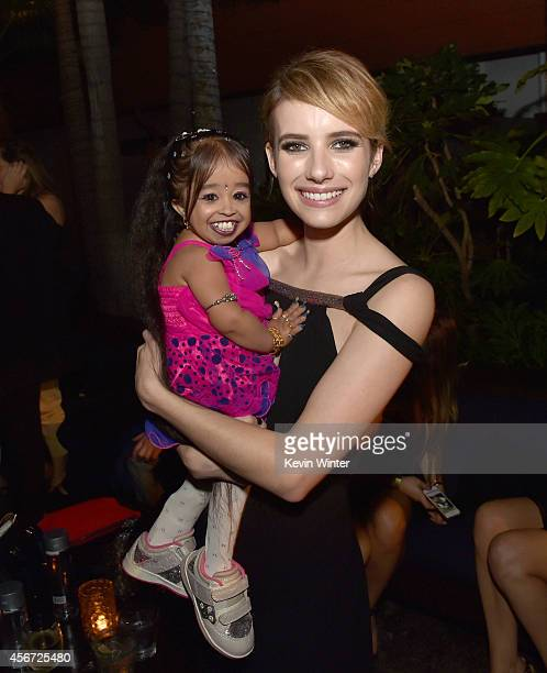 Actresses Jyoti Amge and Emma Roberts pose at the after party for the premiere screening of FX's 'American Horror Story Freak Show' at the Roosevelt...