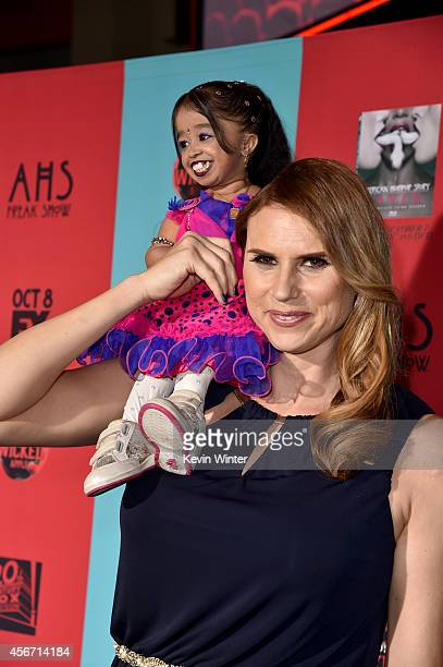 Actresses Jyoti Amge and Erika Ervin attend the premiere screening of FX's American Horror Story Freak Show at TCL Chinese Theatre on October 5 2014...