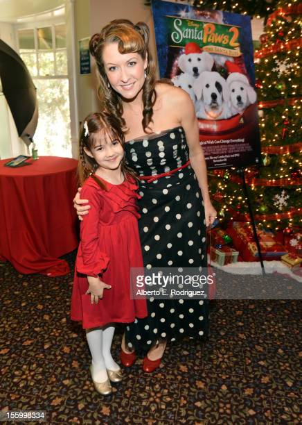 Actresses Kaitlyn Maher and Ali Hillis attend the 'Santa Paws 2 The Santa Pups' holiday party hosted by Disney Cheryl Ladd and Ali Landry at The...