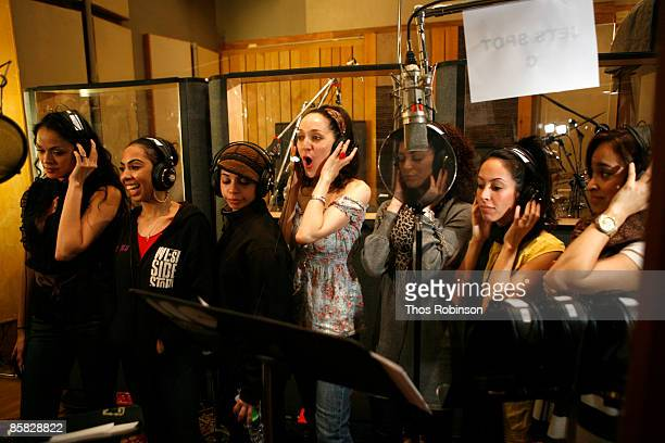 Actresses Karen Olivo and Jennifer Sanchez perform with other singers at a recording session for West Side Story at Clinton Studio on April 6 2009 in...
