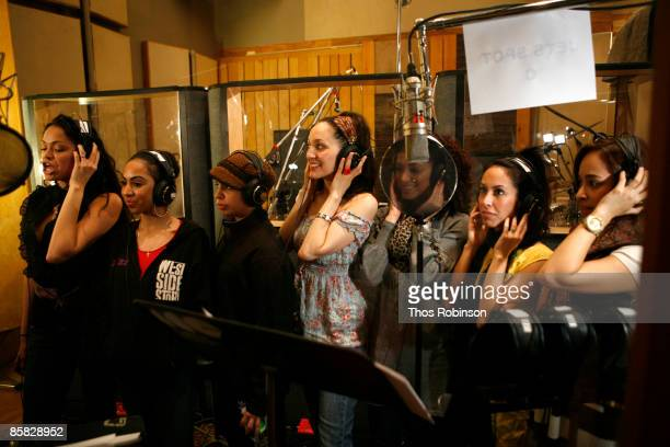 R Actresses Karen Olivo and Jennifer Sanchez perform with other singers at a recording session for West Side Story at Clinton Studio on April 6 2009...