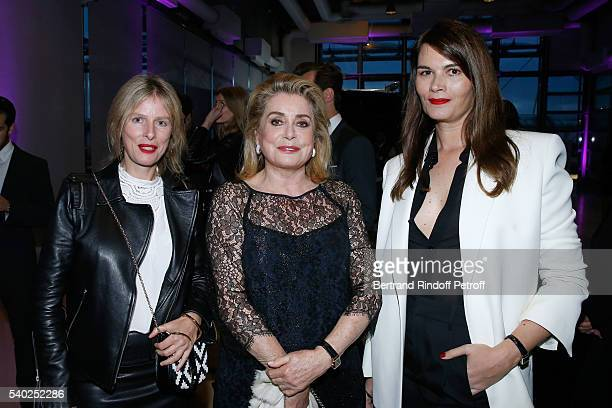 Actresses Karin Viard Catherine Deneuve and Marina Hands attend YSL Beauty launches the new Fragrance 'Mon Paris' at Cafe Le Georges on June 14 2016...
