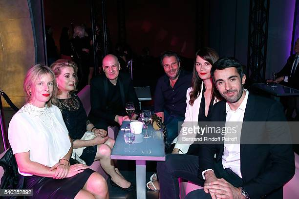 Actresses Karin Viard Catherine Deneuve General Director of of Yves Saint Laurent Stephan Bezy Carl Ganem actress Marina Hands and guest attend YSL...