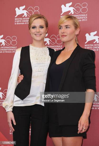 Actresses Kate Winslet and Evan Rachel Wood poses at the Mildred Pierce photocall at the Palazzo del Cinema during the 68th Venice Film Festival on...