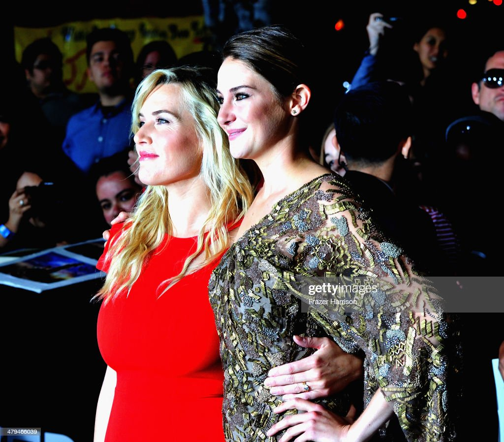 Actresses Kate Winslet and Shailene Woodley arrive at the premiere of Summit Entertainment's 'Divergent' at the Regency Bruin Theatre on March 18, 2014 in Los Angeles, California.