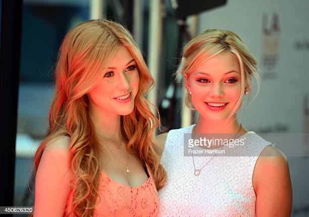 Actresses Katherine McNamara and Olivia Holt attend the premiere of Earth to Echo during the 2014 Los Angeles Film Festival at Premiere House on June...