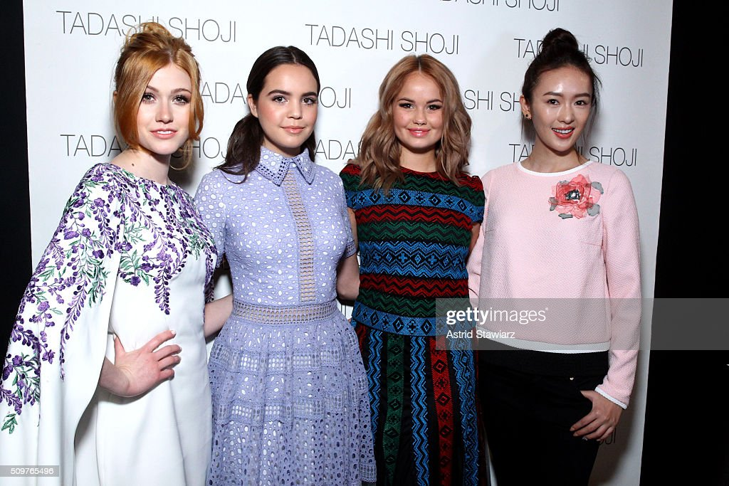 Actresses Katherine McNamara, Bailee Madison, Debby Ryan and Yao Tong pose backstage at the Tadashi Shoji Fall 2016 fashion show during New York Fashion Week: The Shows at The Arc, Skylight at Moynihan Station on February 12, 2016 in New York City.