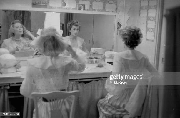 Actresses Kay Kendall and Margaret Leighton sitting together at their makeup station backstage at 'Night of 100 Stars' July 24th 1958