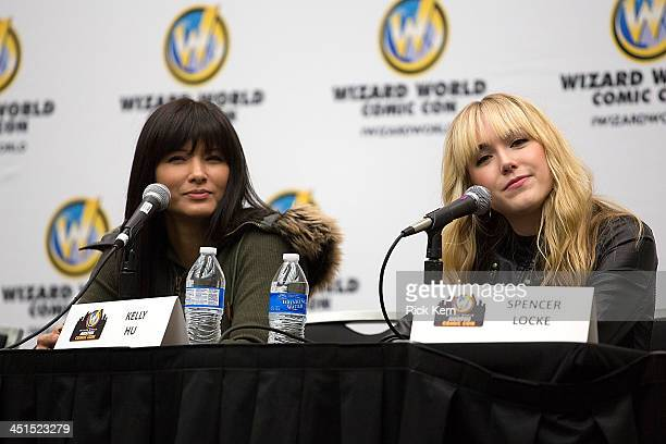 Actresses Kelly Hu and Spencer Locke attend day one of the Wizard World Austin Comic Con at the Austin Convention Center on November 22 2013 in...