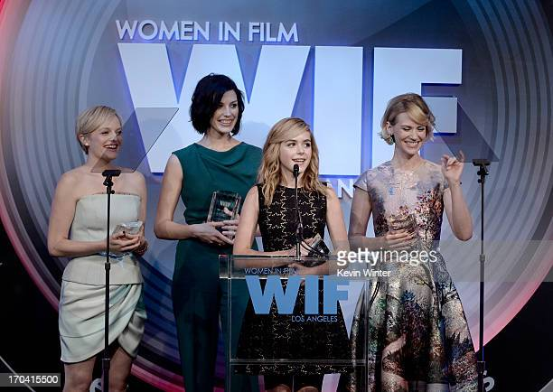 Actresses Kiernan Shipka Jessica Pare Elisabeth Moss January Jones of Mad Men accept the Lucy Award for Excellence in Television onstage during Women...