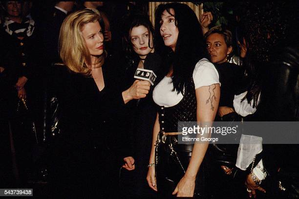 Actresses Kim Basinger Chiara Mastroianni and singer Cher on the set of the film PrêtàPorter directed by American director Robert Altman