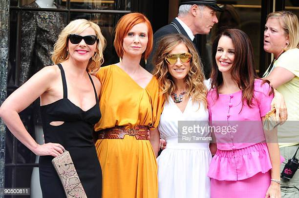 Actresses Kim Cattrall Cynthia Nixon Sarah Jessica Parker and Kristen Davis pose for photos on location at the Sex And The City 2 film set at...