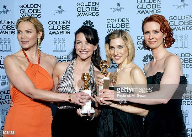 Actresses Kim Cattrall Kristin Davis Sarah Jessica Parker and Cynthia Nixon pose backstage during the 59th Annual Golden Globe Awards at the Beverly...